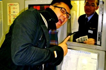 <p>Whether you are on JR or the Subway, there is a help button for most ticket machines. Press the button and the customer service officer will come out and help you behind the counter.</p>