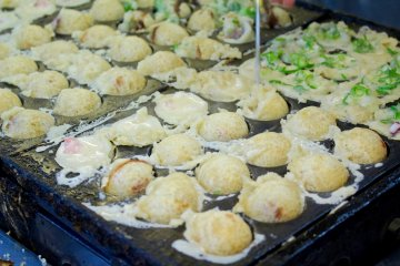 Some coupons can be redeemed for discounts on delicious local foods like takoyaki.