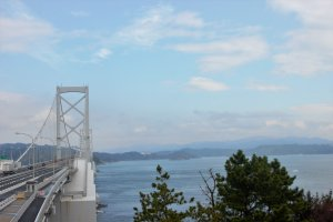 A bridge stretches over the narrowest part of the Naruto Strait. The whirlpools lie underneath.