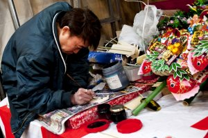 A seller prepares a good luck charm