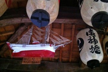 Inside, model ships hang from the rafters indicating the main interests of the shrine's patrons