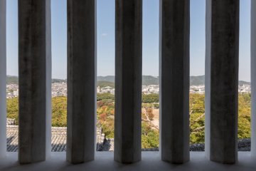 A slotted view through a window inside Himeji Castle