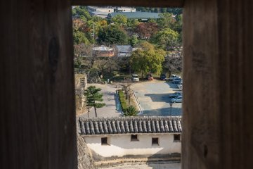 Looking through an archery port in one of the castle walls