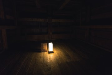 A small lantern lights up a room once used as an armory