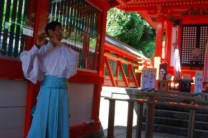 Asuka Shrine's priest plays the flute