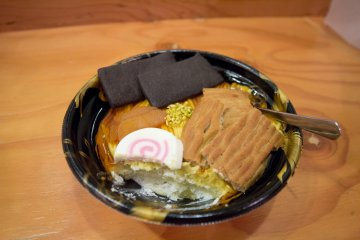The layers of sponge cake and cream found beneath the ramen cover