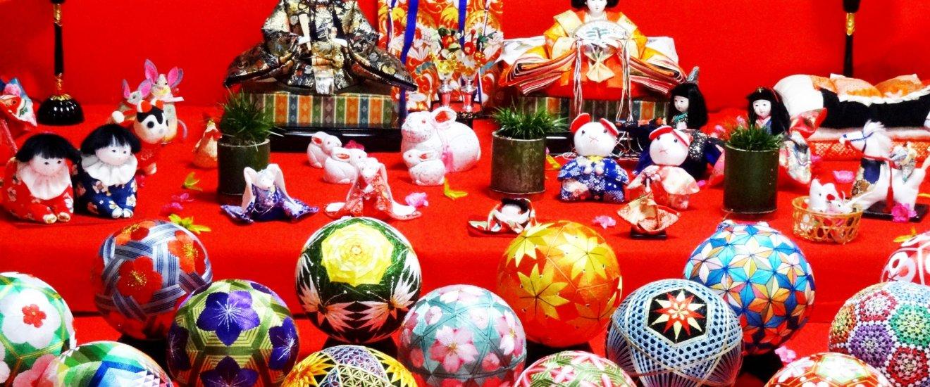 A display of Hina dolls and woven temari