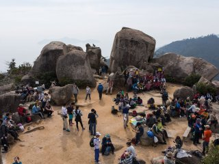 The top of Mt. Misen, walkers sprawled out taking in the view