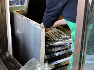 Man operating the toasted squid press