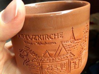 Glühwein in a stylish clay mug