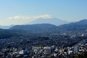 Mt. Fuji rises over the city of Hadano from Mt. Kobo Park