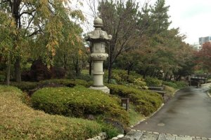Traditional stone lanterns guard the walkways at Tokugawa-En