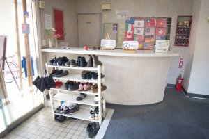 The entrance where you leave your shoes and change into slippers