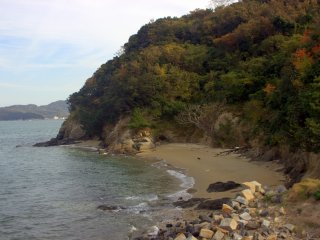 A small, secluded beach. You can see Shido Bay far in the distance to the left