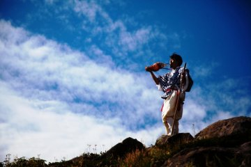 Masanori Naruse blowing his hora (conch shell) on top of Mount Gassan