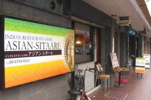 The shop in the Green White and Orange colors of the Indian Flag signal the start of your trip to Indian cuisine at  Asian Sitaare in Kintetsu Fuse in Osaka