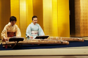 Two women playing the Koto zither
