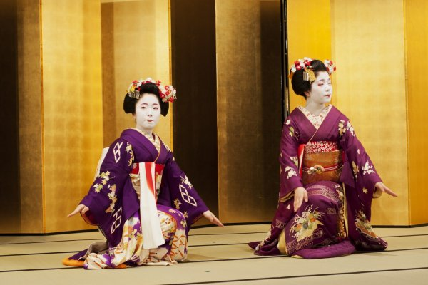 Maiko dancers in beautiful dresses perform the Kyo-mai dance