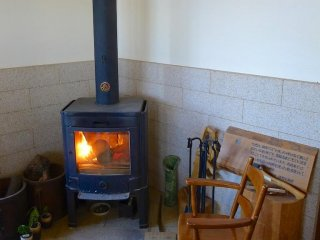 Pull up a chair in front of the wood burning stove