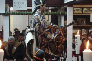 Performers, including this boy, wear elaborate costumes
