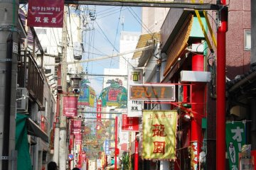 Those two guys in suit look suspicous - Chinese mafia? View of Nagasaki's Chinatown