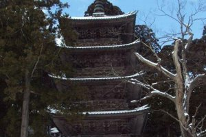 Matching five story pagodas decorate Dewa Sanzan. One marks the footpath to a mile of 2,446 stairs to the top of Mt. Haguro.
