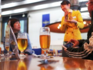 The tour guide also shows you what the best way to pour the beer is