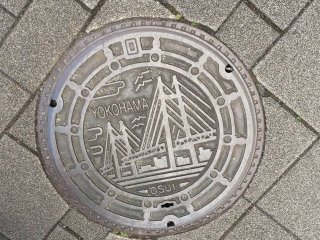 Yokohama's bridge features prominently in the area manhole cover