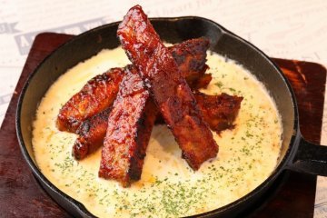 Spare ribs in a grilled cheese fondue