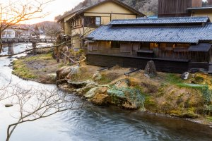 Daimaru Ryokan, with overflow pipes depositing colorful minerals on the riverbank