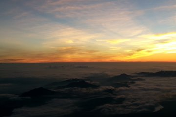 The rising sun above the clouds