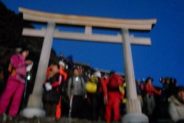 The torii gate that welcomes you to the peak
