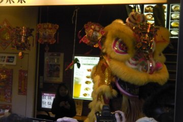 The lion emerges from a Chinatown shop