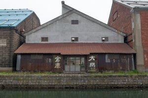 Old warehouses line Otaru canal