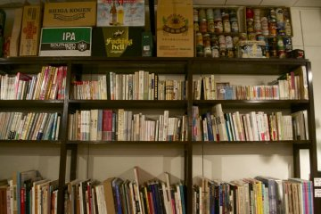 A wall of books that has since been replaced with a door to a newly added second room.