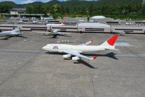Tobu World Square Narita Airport with taxiing aircraft