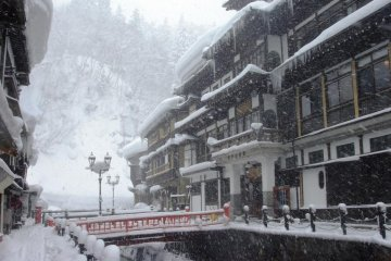 Snow piles up high in winter at Ginzan Onsen