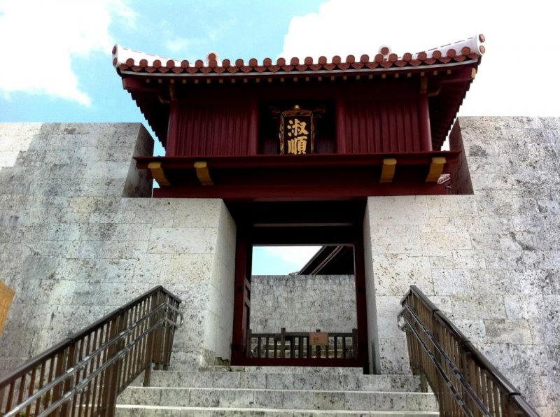 Climb the many steps to Shuri Castle a world heritage site in Naha Okinawa