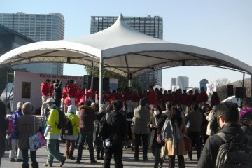 Singers entertain the crowd outside Tokyo Big Sight
