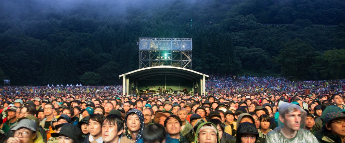 Festival goers in front of the Green Stage