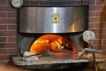 Pizza Savoy's wood-burning oven