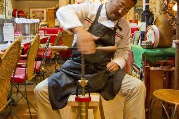 Mr. Takaji demonstrates a pasta-making handtool