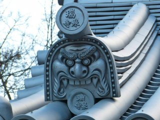 A gargoyle on the roof of the entrance gate
