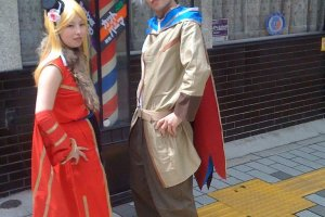 Cosplay Couple in front of Barber shop