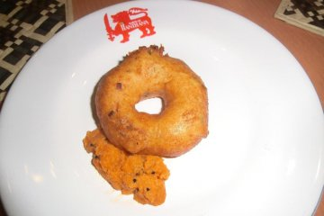 Looks like a donut but is a ring of wheatflour, dipped in curry