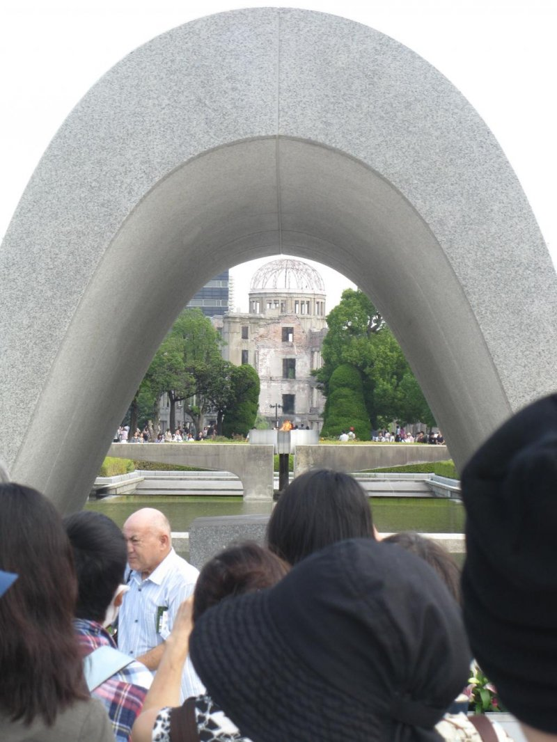 The Flame of Peace and A-Bomb Dome are visible through the cenotaph