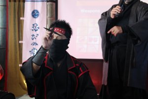 Demonstrating the ninja throwing stars, 'shuriken'