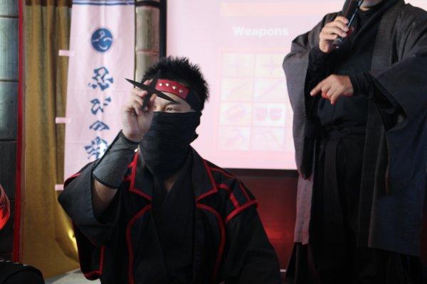 Demonstrating the ninja throwing stars, \'shuriken\'
