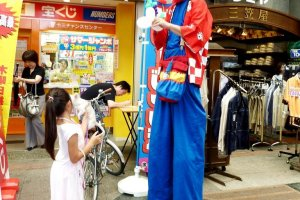 The lottery man wants to make your dreams come true at Juso Friendly Street just 10 minutes from Osaka Umeda