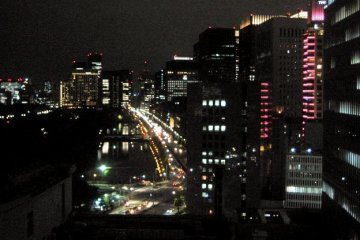 Bright lights of Ginza and Hibiya Park from Imperial Hotel Tokyo